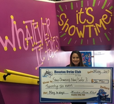 Houston Swim Club made another monthly donation to the Stop Drowning Now foundation.